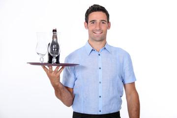 A waiter bringing a bottle of liquor.