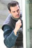 Man installing double-glazed window