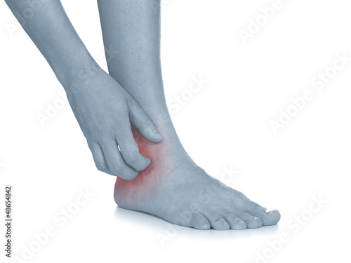 Women scratch itchy ankle with hand.