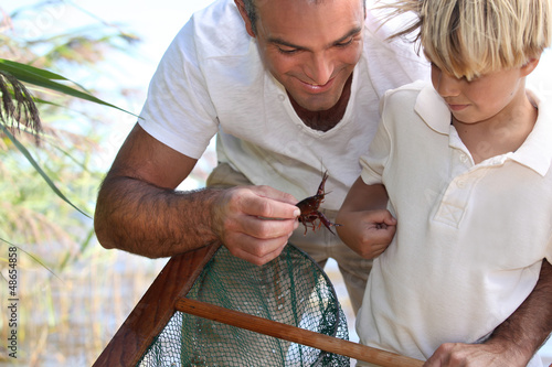 Father and son with a fishing net