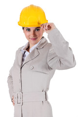 Woman with gray suit and yellow helmet