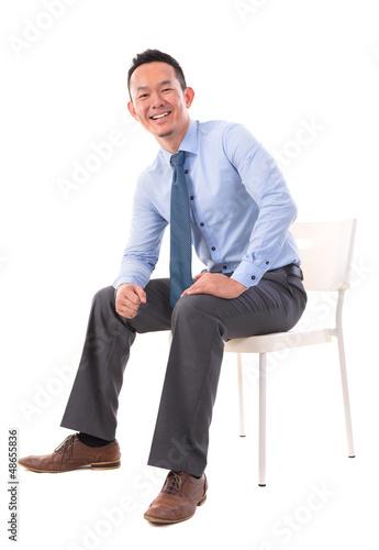 Full body Asian business man sitting