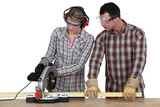 Apprentice with circular saw