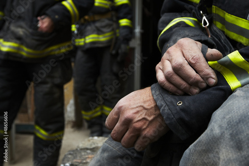 Sadness and hope. Firefighter resting during the rescue work.