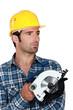 Man holding circular saw