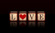 love with red heart in 3d wooden cubes
