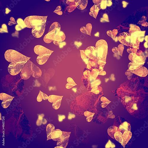 golden hearts over violet background