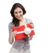 Young woman hands a present wrapped in red paper