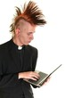 Happy young priest with laptop