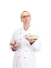 Baker with gingerbreads and stollen