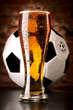 glass of lager with soccer ball