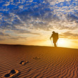 hiker walk by a sandy desert