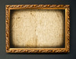 Empty golden frame on grunge wall