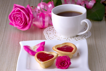 Holiday Tartlets with jam near the cup of tea