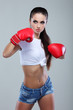 Beautiful sexual boxing girl, fitness, on a grey background