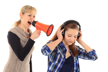 Young woman screaming at her daughter with a megaphone on white