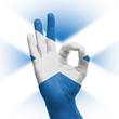 hand OK sign with Scottish flag