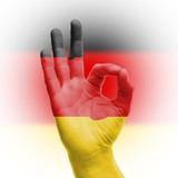 Fototapety hand OK sign with German flag