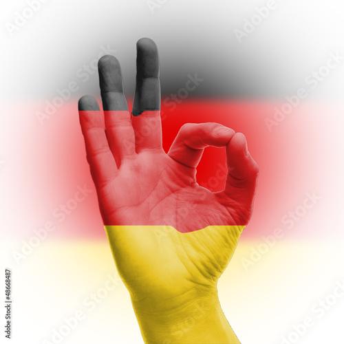 Fototapeta samoprzylepna hand OK sign with German flag