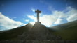 Crucifix on the mountain with sunrays