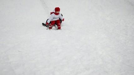Family sledding, snow covered the hills, falling sledge