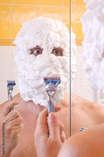 man is preparing to shave