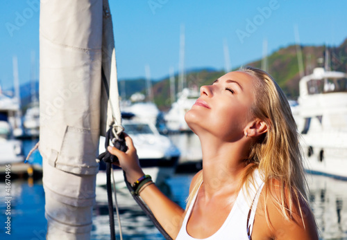 Woman tanning on luxury yacht