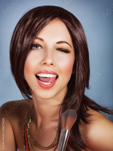 Woman with brush for blush