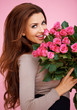 Laughing romantic woman with roses