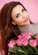 Beautiful smiling woman with roses