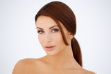 Sensual brown haired woman with bare shoulders