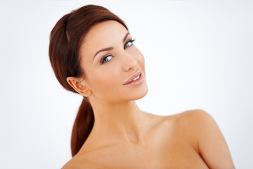Smiling woman with naked shoulders