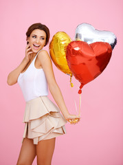 Vivacious woman with heart shaped balloons