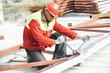 builder worker assembling metal construction