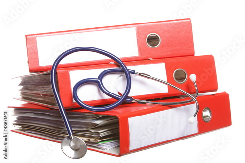File folders with stethoscope isolated on white