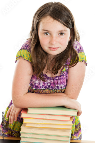 Elementary School Girl on Leaning on Stack of Books