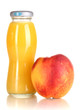 Delicious peach juice in glass bottle and peach next to it