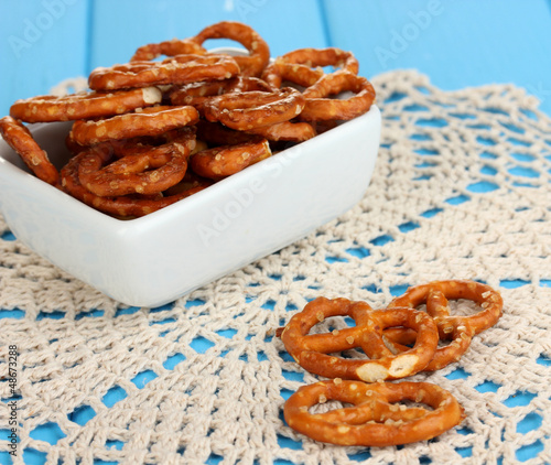 Tasty pretzels in white bowl and milk jug
