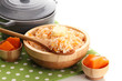 Taste rice porridge with pumpkin, isolated on white.