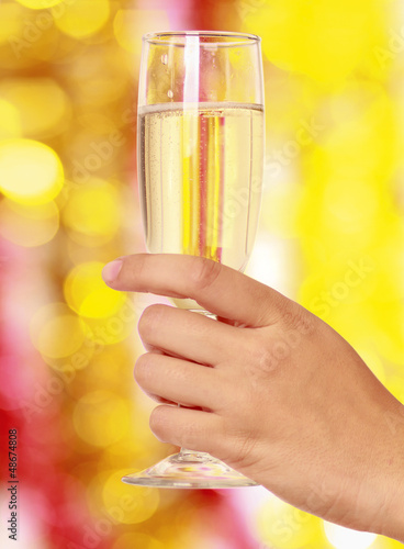 Beautiful woman drinking champagne at christmas