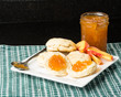 Biscuits with jar of peach jam