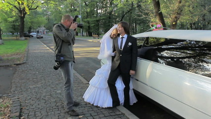 young marrying couple . Photographing process in city. wedding