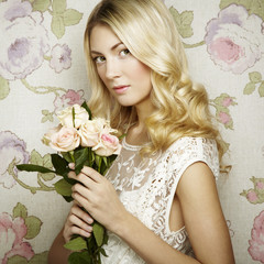 Portrait of a beautiful blonde woman with flowers