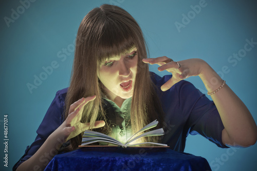 The girl conjures with the book