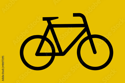 Yellow sign with painted bicycle