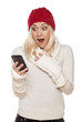pleasantly surprised girl with red hat reading a text message