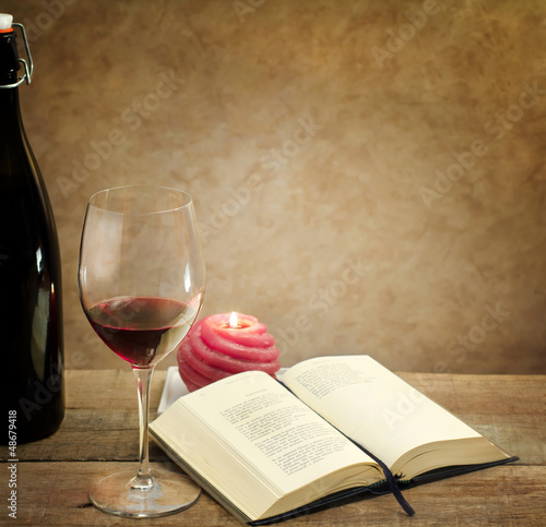 relaxing moment with wine glass and poetry book
