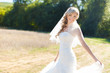 Portrait of beautiful blond bride in action. Wedding dress.
