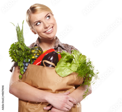 Woman with a shopping bag filled with nutritious fruit and veget