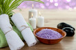 SPA with aromatic burning candles, towel and lavender bath salt